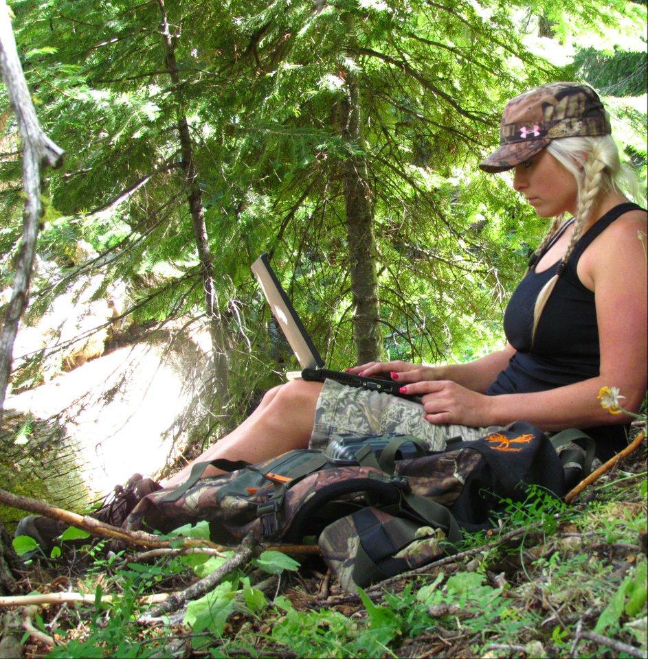 Kristy Titus checking trail cam pics u2013 Elk Hunter Magazine